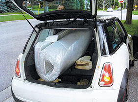 folded mattress in small car van suv